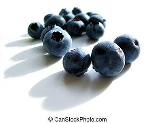 Blueberries macro on white