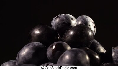 Blueberries on black background close up isolated