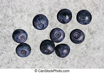 Blueberries on the background of a concrete wall