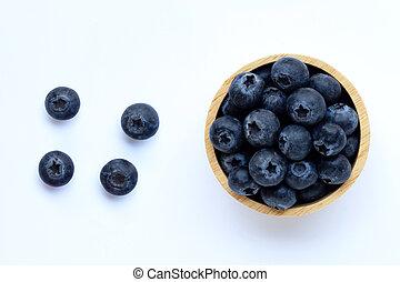 Blueberries on white background.