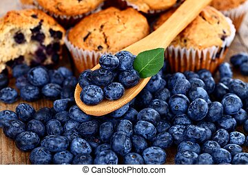 Blueberries on wooden spoon - Homemade muffins with fresh...