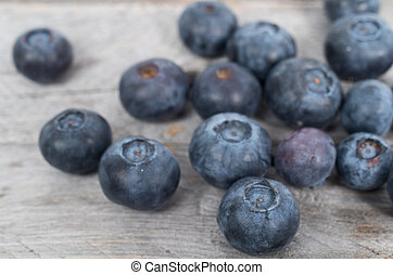 Blueberries on wooden table, selective focus
