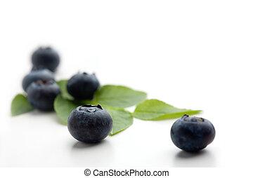 Blueberries - Pile of blueberries on white