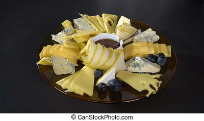 Blueberries spread on a plate with cheese - Cook lays...