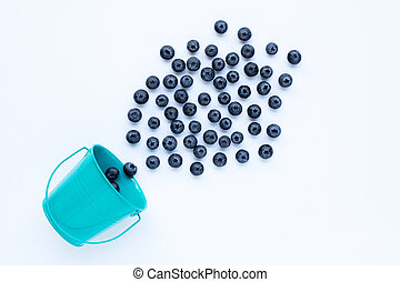 Blueberries with bucket isolated on white