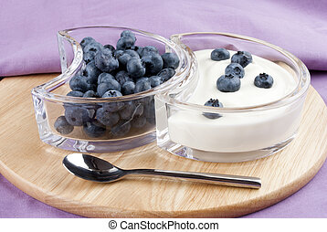 blueberries with fresh yogurt and a spoon