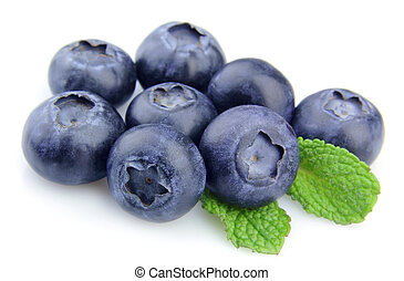 blueberries with mint on white close up