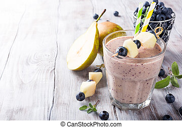 Blueberry and pear smoothie in a glass