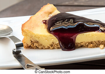 Blueberry Cheesecake with little spoon on a plate