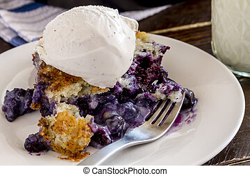 Blueberry Cobbler Baked in Cast Iron Skillet - Close up of...