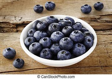 Blueberry fruit on wooden background