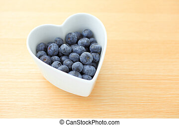 Blueberry in a heart shape bowl