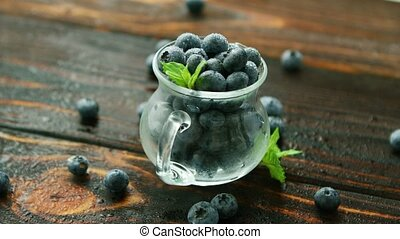 Blueberry in small jug - Closeup blueberry in jar and...