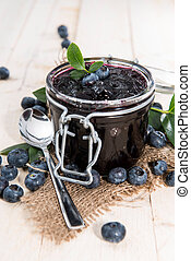 Blueberry Jam in a glass with fresh fruits