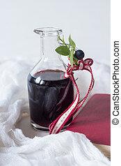 Blueberry juice in a glass bottle