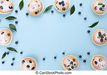 Blueberry muffins light blue background