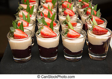 blueberry panacotta in small glass top fresh strawberry