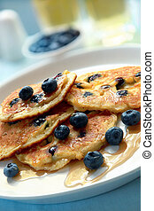 Blueberry Pancakes - Blueberry pancakes with maple syrup. An...