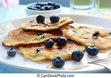 Blueberry Pancakes - Blueberry pancakes with maple syrup. ...