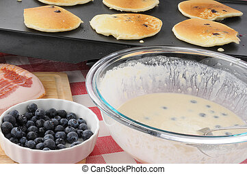 Blueberry pancakes cooking on the grill - Blueberry pancakes...