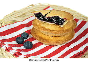 blueberry pie stack on striped napkin