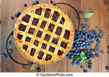 Top view of a blueberry pie