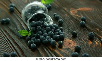 Blueberry scattering from glass jug - Closeup blueberry...