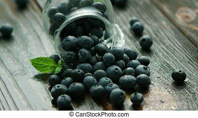 Blueberry scattering out of jug - Closeup fresh appetizing...