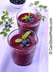 Blueberry smoothie in glasses, healthy drink