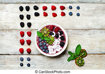 Blueberry smoothies breakfast bowl with coconut flakes,...