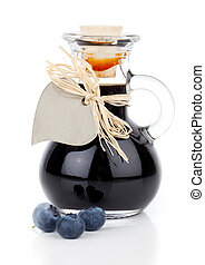blueberry syrup in glass bottle or mixture, with heart label. on white background.