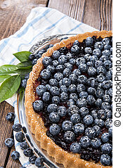 Blueberry Tart on vintage wooden background