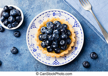 Blueberry tart, pie, tartlet with vanilla custard