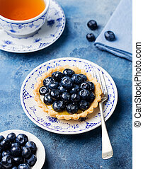 Blueberry tart, pie, tartlet with vanilla custard.