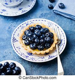 Blueberry tart, pie, tartlet with vanilla custard.