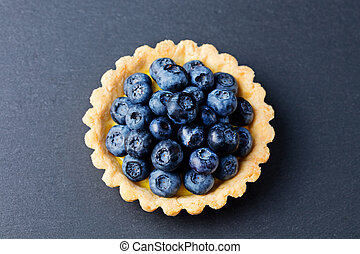 Blueberry tart, pie, with vanilla custard Top view
