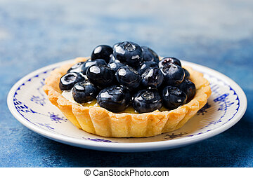 Blueberry tartlet, pie, tart with vanilla custard.