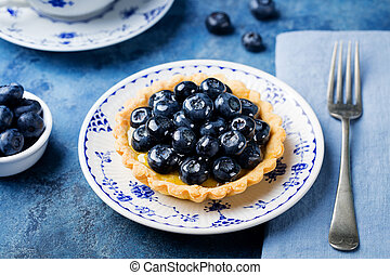 Blueberry tartlet, pie, tart with vanilla custard.
