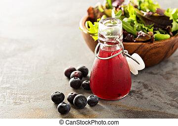 Blueberry vinaigrette salad dressing in small bottle