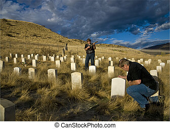 Bluegrass band plays a lament in a military cemetery