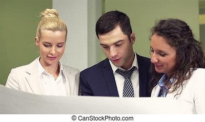 Blueprint Collaboration - Positive business people...