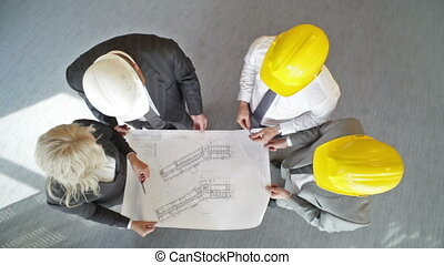 Blueprint discussion - The above view of an engineering team...