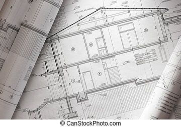 Blueprint - House plan blueprints roled up over table