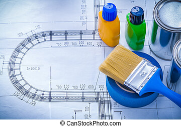 Blueprint with paint brush metal cans plastic bottles and...
