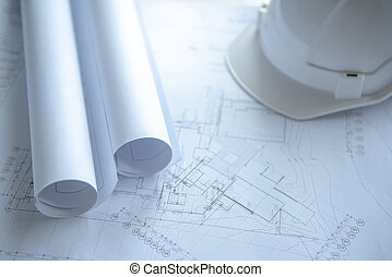 Blueprints and helmet on working table