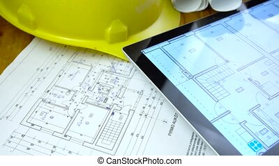 blueprints, tablet and other stuff on table - blueprints,...