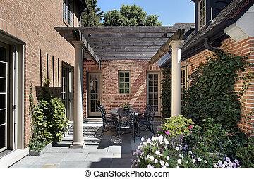 Bluestone patio with columns and wood pergola