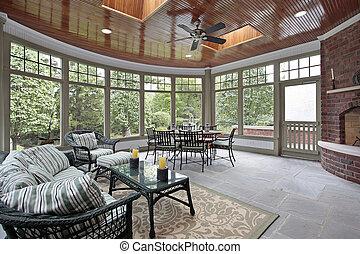 Bluestone porch with brick fireplace