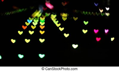 blur and bokeh heart shape change color on runway floor on night light of shopping mall