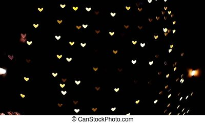 Blur and bokeh heart shape of vehicle and car on the night road
